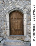 old door with wood and stone | Shutterstock . vector #393598729