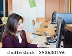 woman working on pc sitting... | Shutterstock . vector #393630196