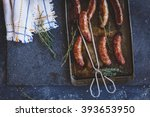 overhead of grilled sausages in ... | Shutterstock . vector #393653950
