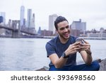 young man texting on his...   Shutterstock . vector #393698560