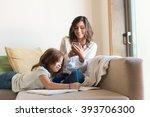little girl painting in the... | Shutterstock . vector #393706300