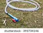 rubber tube on grass in the... | Shutterstock . vector #393734146