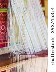 thread from weaving machine ... | Shutterstock . vector #393745354