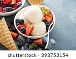 Stock photo vanilla ice cream scoops with fresh berries 393753154