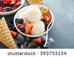 Stock photo vanilla ice cream scoops with fresh berries 393753154