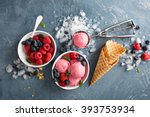 Stock photo raspberry ice cream in white bowl overhead shot 393753934