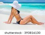Young Woman In Bikini Sitting...