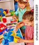 group little girl with brush... | Shutterstock . vector #393833689