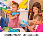 woman with little girls playing ... | Shutterstock . vector #393833836