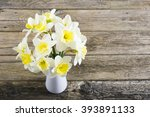 white daffodils at china vase... | Shutterstock . vector #393891133
