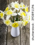 white daffodils at china vase... | Shutterstock . vector #393891196