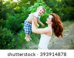 mother with long curly red hair ...   Shutterstock . vector #393914878