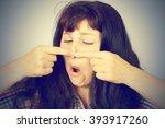 beautiful young woman squeezing ... | Shutterstock . vector #393917260