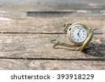 Stock photo pocket watch on old wood 393918229