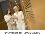 young women with tablet in the... | Shutterstock . vector #393928399