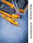 Small photo of Digital ammeter electrical tester multimeter on metallic background electricity concept.