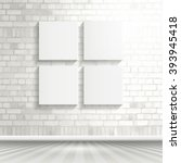 four blank canvases on a white... | Shutterstock .eps vector #393945418