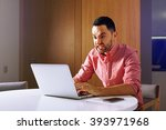 Small photo of Male angry student work on computer touch pad, young angry business man use laptop sitting at wooden table of home, angry freelancer working on notebook at kitchen. angry entrepreneur and furious