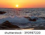 Sunset's Wave Splashes On Sea