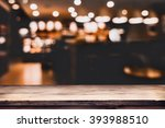Stock photo blurred background of bar and dark brown desk space of retro wood 393988510