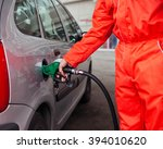 male worker at gas station... | Shutterstock . vector #394010620