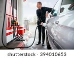 man at gas station filling up... | Shutterstock . vector #394010653
