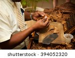 hand making cigars from tobacco ... | Shutterstock . vector #394052320