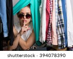 young hipster woman sorting her ... | Shutterstock . vector #394078390