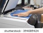 woman hands putting a sheet of... | Shutterstock . vector #394089424