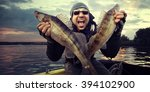 happy angler with zander... | Shutterstock . vector #394102900