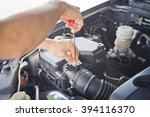 car mechanic working in the... | Shutterstock . vector #394116370