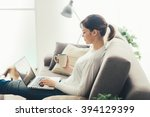 young woman relaxing at home on ... | Shutterstock . vector #394129399