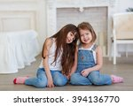 two little girls sisters hugging | Shutterstock . vector #394136770