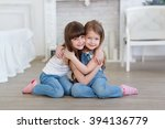 two little girls sisters hugging | Shutterstock . vector #394136779