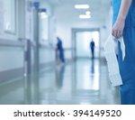 doctor with ecg in hand on... | Shutterstock . vector #394149520