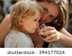 smiling young mother holding... | Shutterstock . vector #394177024