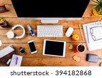 desk with various gadgets and