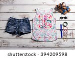 lady's outfit with jeans shorts.... | Shutterstock . vector #394209598
