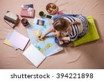 young woman making marks on the ... | Shutterstock . vector #394221898