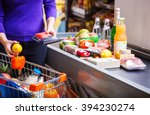 young woman putting goods on... | Shutterstock . vector #394230274
