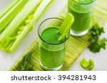 glass of green smoothie on... | Shutterstock . vector #394281943