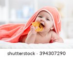 Cute Baby With Teether Under A...