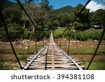 suspension bridge over the... | Shutterstock . vector #394381108