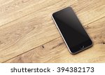 smartphone with black screen on ... | Shutterstock . vector #394382173