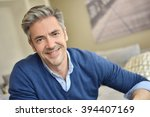 portrait of smiling handsome... | Shutterstock . vector #394407169
