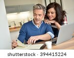 couple at home using laptop... | Shutterstock . vector #394415224