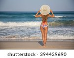 girl in a hat on the beach sea... | Shutterstock . vector #394429690