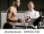 Small photo of Man running on treadmill during medical test and medic in white uniform