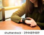 woman touch on smart watch in... | Shutterstock . vector #394489489