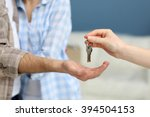 female hand giving keys from... | Shutterstock . vector #394504153